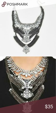 NWT Statement Necklace Gorgeous chrome and silver rhinestone statement necklace. Complete any outfit! Boutique  Jewelry Necklaces