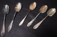 These spoons, salvaged from the wreckage of the Titanic on the ocean floor, were part of an exhibit at the Maritime Aquarium, in South Norwalk, Conn., Feb. 1, 2002. RMS Titanic, Inc. is the sole salvage company allowed to remove items from the ocean floor where the luxury liner sank in the North Atlantic. (Douglas Healey/Associated Press)