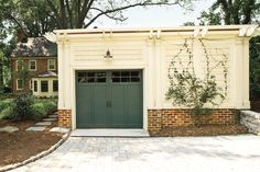 A rustic home calls for garage doors that fit the part. Decorative X braces impart the look of stable doors while grooved cedar panels echo the reclaimed wood siding