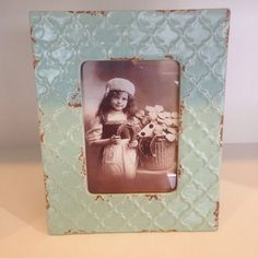 Blue Ceramic Picture Frame Inject a wee bit of colour with this beautiful light blue picture frame. Intentionally distressed to...