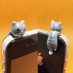 Adorable Grey Hanging Cat Kitten Anti Dust Plug 3.5mm Phone Accessories Charm Headphone Jack Earphone Cap for iPhone 4 4S 5 iPad HTC Samsung. $3.99, via Etsy.