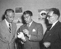 Heinz Haber, Wernher von Braun, and Willy Ley examine a prop from the Disney movie Man in Space (©Walt Disney Productions).