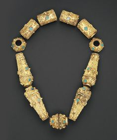 Christie's Sale 7571 | Lot 58 : Seljuk Turquoise Inset Gold Necklane, Iran, 12th century. Comprising twelve parts