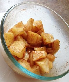 """Baked"" Cinnamon Apples. Kendra's recipe has coconut oil, cinnamon, nutmeg & a sliced apple, in the microwave."