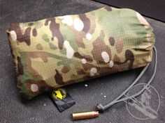 TEOTWAWKI Blog: Review: Bushcraft Outfitters Ultralight Multicam MEST - A 7 ounce survival shelter that compresses down smaller than a canteen!