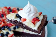 Fruity Brownie Dessert Pizza     1 boxed brownies mix (for a 9x13-inch pan)     2 eggs     1/4 cup water     1/2 cup oil     8 oz cream cheese, softened     1/2 cup powdered sugar     2 bananas     lemon juice     1 1/2 cups diced strawberries     1/2 cup blueberries     8 oz COOL WHIP whipped topping