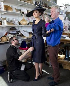 Sebastien Zaffalon (left), one of the tailors from Giorgio Armani Privé studios in Milan, with Sophie Windsor, the wife of Lord Frederick Windsor, and Philip Treacy, being fitted only hours before the royal wedding