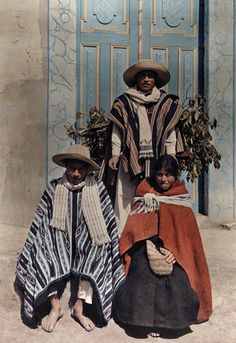 South America | Portrait of three Quechua indians wearing a traditional clothes, Peru