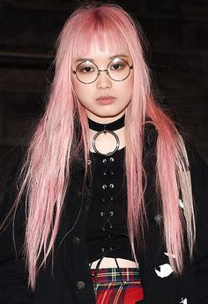 Welcome to the look that bonafide proves that straight hair doesn't mean lifeless. To tap into Fernanda Ly's rebellious vibe, let your long locks hang down (or take a sneaky extensions shortcut), and cut in a choppy, full fringe. To finish? Hairspray, zhush, repeat (hairspray, zhush, repeat – you got this)