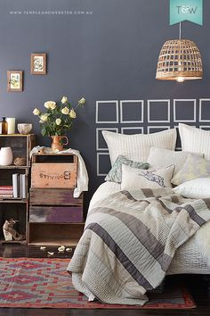 Vintage crates form a bedside table with storage. Jasmine Hall linen. Styled & shot by Temple & Webster.