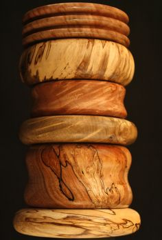 Hand turned wood bangles and cuffs http://www.etsy.com/shop/KindaKnotty?section_id=14551509