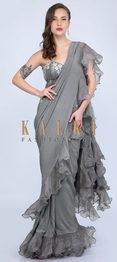 Buy Online from the link below. We ship worldwide (Free Shipping over US$100)  Click Anywhere to Tag Anupriya Goenka in Kalki coin grey ready pleated draped saree with organza ruffled hem and pallo Coin grey ready pleated crepe saree with cut dana and 3 D flower embroidered waist.It is designed with pre stitched pleats and ready pleated draped pallo.The hem and pallo border of the saree are further enahanced with organza ruffled layer