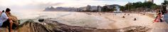 https://flic.kr/p/EcyMzM | Ipanema Beach panorama | A panorama photo taken in 2014 at Ipanema Beach, Rio de Janeiro, Brazil, just before sunset. (The sunset was not as spectacular as it can be at this place, due to the clouds in the distance.)  The panorama photo was stitched from nine photos, taken with an Olympus PEN E-PL1 camera and Panasonic Lumix 20mm f/1.7 pancake lens.    See where this photo was taken.