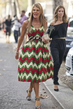 Anna Dello Russo in a printed, full-skirt sundress and animal print add-ons.