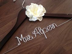 Wedding Dress Hanger, Bride Hanger, Bridal Hanger, Personalized Hanger, Bridesmaid Hangers, Bride Gift, Ivory Flower. $35.00, via Etsy.