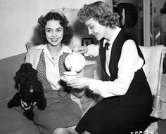 0 Jennifer Jones with her poodle and Claudette Colbert have a cup of tea between takes while Since-You-Went-Away-1944