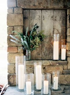 Simple, elegant wedding decor with lots of candles and some greens for a rustic wedding setting.