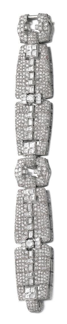 DIAMOND BRACELET, CARTIER, 1930S The articulated band of open work design, set with a graduated line of circular-cut diamonds, framed with pavé-set circular- and single-cut stones, a rectangular motif to the front and back set with carré-cut diamonds, signed Cartier, numbered, French assay marks.