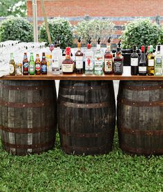 The bar featured aged barrels. #RusticWedding Photography: Stacy Newgent. Read More: http://www.insideweddings.com/weddings/rustic-barn-wedding-tented-reception-on-family-farm-in-ohio/690/