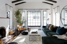 A Captivating Update for a Spanish Style Home | Interior Design by Jesse DeSanti of Jette Creative | Photography by Amy Bartlam | Modern Sanctuary | Living Room Inspiration | Bohemian Living Room | Contemporary Living Room | Eclectic Living Room | Seating | Modern Seating
