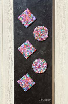 Marlene Brady.  The magnetic polymer clay tiles reconfigured.  If you get tired of them on the canvas, you can turn your refrigerator into a piece of art.