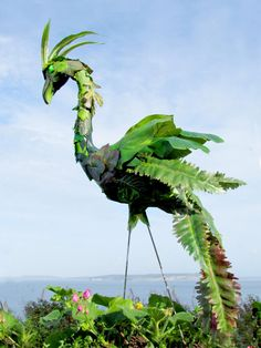Camouflage Flamingo - handmade, garden art sculpture created from a recycled pink plastic flamingo.. $75.00, via Etsy.