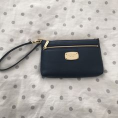 Michael Kors dark blue clutch- leather New!! The receipt is even inside! I have a lot of clutches so decided to let this one free :) so beautiful and light. Pretty gold details. Credit card pockets inside and zipper outside. Michael Kors Bags Clutches & Wristlets