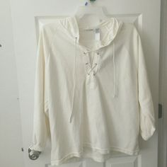 Awesome White top with hood This comfortable top is a variation of the classic hoodie. It laces up about 5 inches to the neck. It's super soft. This is like a light weight sweater..but lighter. g is gone but I would guess itts a XL--1X Tops Sweatshirts & Hoodies