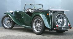 1946 MG TC  (Just like my great-great-Great Uncle Marion's, His was the Dark Green WITH tan runners and fenders , leather interior,all wood dash! GORGEOUS CAR)