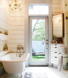 Love love love this bathroom! From the walls to the light to the tub to the inlaid shelves. Well done.