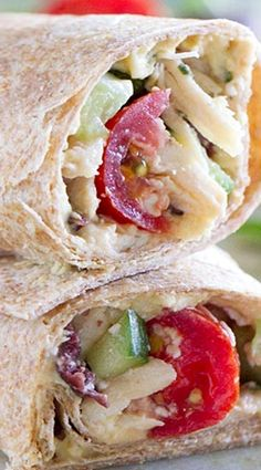 Greek Chicken Wrap Recipe _ For this chicken wrap recipe, you combine all kinds of great Greek flavors to make an easy lunch or dinner wrap. I'm a sucker for a good wrap recipe, & I love Greek flavors, so I knew this one would be a hit. And bonus – it's actually low in calories so it's a healthy lunch or dinner recipe, as well. Winner!