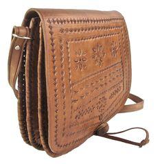 82746a6e2b45 I found this Vintage Tooled Leather Satchel on www.peekaboovintage.com