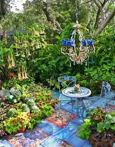 Oh! Joy! Love the Chandelier and the Angel Trumpet plant and the......