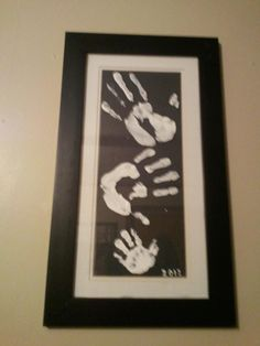 Daddy, Mommy, Baby handprints! :) Two dollar frame from goodwill plus black posterboard and white paint (painted on top of the glass, not the paper...wasn't sure if it would bleed and turn to grey)...DIY