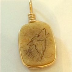 Vintage Eskimo Artisan pendant necklace wolf howls This was purchased by my parents along with a ton if other Eskimo Inuit and native art and jewelry you can find in our etsy a little less on one of their sled team runs. They had a pack of wolves and Huskies (still have Huskies) that they competitively raced all over in the 60s 70s & 80s. I am not sure if this dime sized little beauty is carved bone or stone but my guess is some kind of jasper. It has a gold tones wire wrap frame ending in…