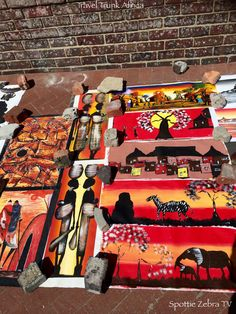 Vibrant, colourful paintings on the roadside in Camps Bay.