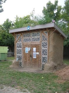 our straw bale shed with pounded tire foundation, green roof and bottle wall