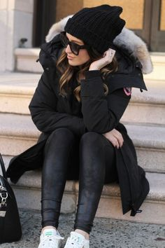 LOVE!  All black winter style - beanie and Canada Goose parka (and Adidas Stan Smith sneakers)