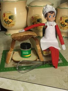 Elf on the Shelf and a gingerbread house