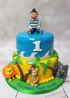 This is so cute, two tier jungle themed first birthday cake