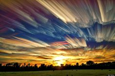 """Usually to experience a sunset in its entirety, one must devote a couple of hours to watching the majestic motion of the sky as the sun floats downward until it's completely out of view. Thanks to photographer Matt Molloy, we can now experience the visual power of the setting sun in a single image. He calls the technique """"timestacking."""""""