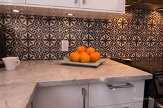 Orange plate over kitchen counter-top