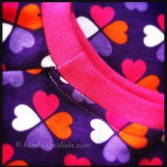 Hoe afwerken met tricotboord aan de hals