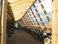 Duke Framing - tire-bermed walls & front face framing for passive solar section of Modular Earthship -- photo by Earthship Kirsten, via Flickr