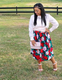 blush pink button up top with blush pink ankle strap heels and red, pink, green, and black floral print skirt. modest outfit idea