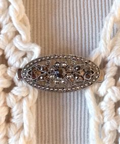 """The mattie slender antiqued silver tone filigree black stone flower sweater clip brooch. This slender clip is about 1/2"""" tall and about 1 1/4"""" long . The silver tone sweater clips help keep your cover ups closed and are easy to put on and off. $13 www.mattieandco.com"""