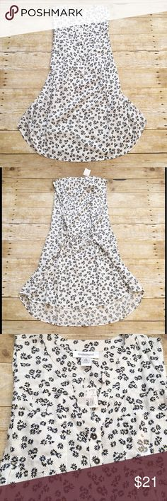 NWT white floral tank/tunic, Motherhood Maternity Gorgeous NWT floral tank/tunic top from Motherhood Maternity in a size large. Navy and yellow flowers. Perfect for that beautiful baby bump! Ties around the waist. Motherhood Maternity Tops Tunics