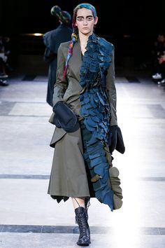 Imagine this coat swanning out of a talk show studio or to lunch in Paris. Yohji Yamamoto | Fall 2014 Ready-to-Wear Collection | Style.com