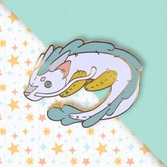 Accessories ranging from enamel pins, stickers, lanyards, and handmade items.