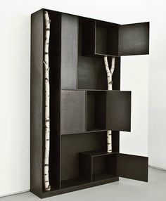 If It's Hip, It's Here: Mondrianesque Metal Shelving By Andrea Branzi Incorporates Real Birch Trees wow